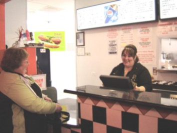 Mr C's Hot Dogs Restaurant Elgin Steph taking care of a customer